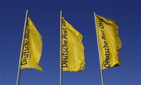 Flags are seen at the headquarters of the German postal and logistics group Deutsche Post AG in Bonn March 9, 2010. REUTERS/Ina Fassbender