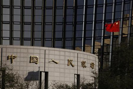 China's nation flag flies in front of the headquarters of the People's Bank of China, the central bank, in Beijing. REUTERS/Soo Hoo Zheyang