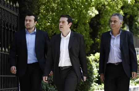 Head of Greece's Left Coalition party Alexis Tsipras (C) leaves the presidential palace after a meeting in Athens May 13, 2012. REUTERS/John Kolesidis
