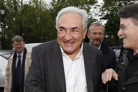 Former IMF head Dominique Strauss-Kahn (C) and Francois Pupponi (2ndR), Deputy Mayor of Sarcelles arrive at a polling station in the second round of the 2012 French presidential elections in Sarcelles in this May 6, 2012, file photo. REUTERS/Gonzalo Fuentes/Files