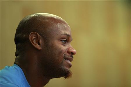 Jamaican runner Asafa Powell attends a news conference ahead of the IAAF Diamond League Athletics meet in Shanghai May 18, 2012. REUTERS/Aly Song
