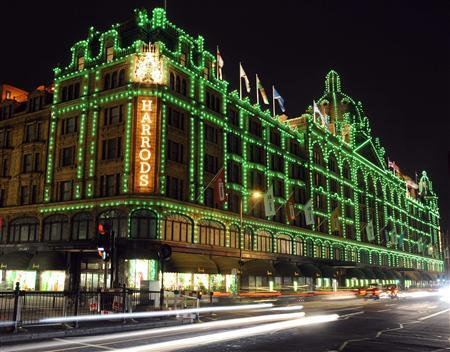 Vehicles drive past the Harrods retail store in London in this October 29, 2009 file photo. REUTERS/Toby Melville/Files