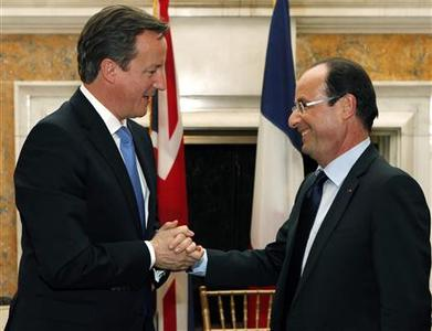 British Prime Minister David Cameron (L) and French President Francois Hollande speak at the end of their meeting at the British ambassador's residence in Washington May 18, 2012. REUTERS/Andrew Winning