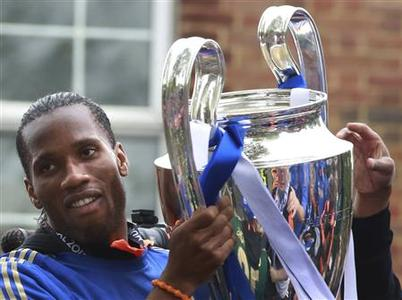 Chelsea's Didier Drogba holds the Champions League trophy during their victory parade in west London, May 20 2012. REUTERS/Olivia Harris