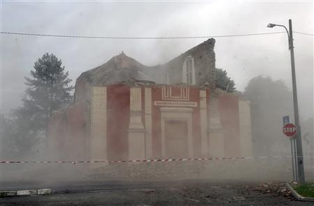 A church that was previously damaged is pictured after it collapsed when a strong aftershock struck Buonacompra May 20, 2012. A strong aftershock measuring magnitude 5.1 hit northern Italy on Sunday, causing more damage and more buildings to collapse, officials and witnesses said. REUTERS/Paolo Bona