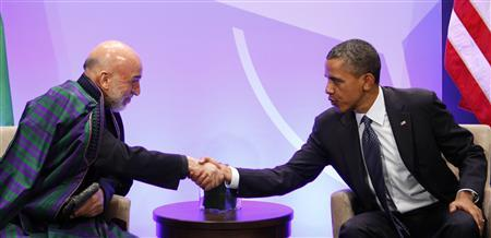 U.S. President Barack Obama (R) shakes hands with Afghanistan's President Hamid Karzai at the NATO Summit at McCormick Place in Chicago, May 20, 2012. REUTERS/Larry Downing
