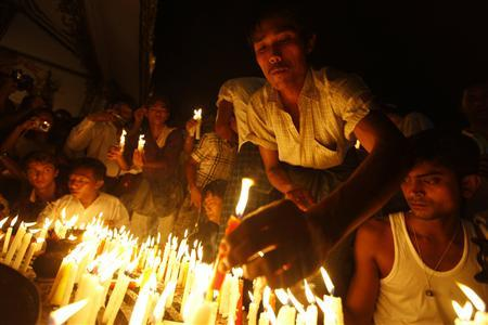 People light candles and pray for electricity during a protest against the shortage of electricity at Sule Pagoda in central Yangon, May 23, 2012. REUTERS/Soe Zeya Tun