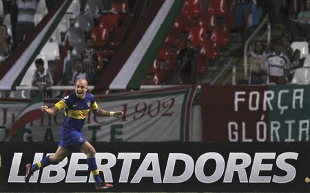 Boca Juniors' Santiago Silva celebrates after scoring a goal against Fluminense during their quarter-final Copa Libertadores soccer match in Rio de Janeiro May 23, 2012. REUTERS/Stringer
