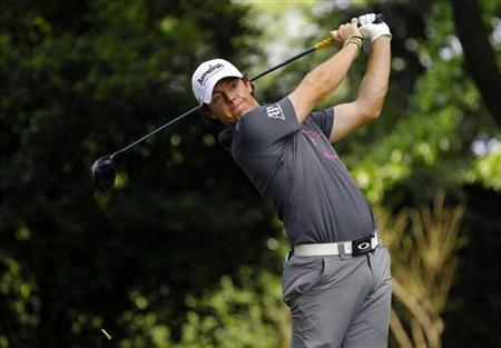 Rory McIllroy of Northern Ireland hits his tee shot on the second hole during a practice round for the 2012 Masters Golf Tournament at the Augusta National Golf Club in Augusta, Georgia, April 3, 2012. REUTERS/Brian Snyder