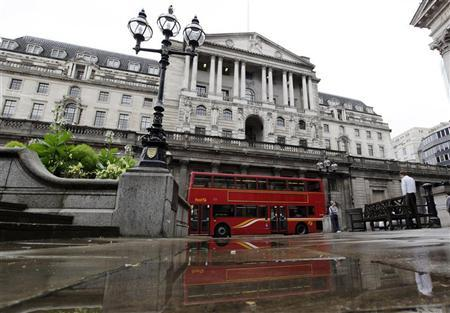A double decker bus is reflected in a puddle after a rain shower outside the Bank of England in the City of London August 4, 2011. REUTERS/Stefan Wermuth