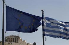 <p>Les quatre plus grandes banques grecques ont bien reçu lundi 18 milliards d'euros de fonds destinés à leur recapitalisation, a déclaré un responsable du Fonds hellénique de stabilité financière (HFSF). /Photo d'archives/REUTERS/John Kolesidis</p>