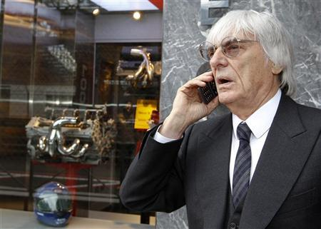 Formula One commercial supremo Bernie Ecclestone speaks on the phone during the Monaco F1 Grand Prix May 25, 2012. REUTERS/Max Rossi
