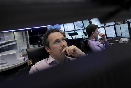 Traders react at their desks at the Frankfurt stock exchange June 5, 2012. REUTERS/Alex Domanski