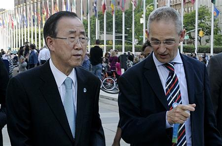 United Nations (U.N.) Secretary General Ban Ki-moon is informed by his spokesperson Martin Nesirky of the killing of seven U.N. peacekeepers in Para, Cote d'Ivoire, at the U.N. headquarters in New York June 8, 2012. REUTERS/Evan Schneider/United Nations/Handout