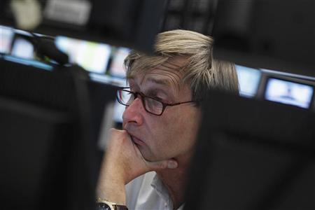 A trader reacts at his desk at the Frankfurt stock exchange June 11, 2012. REUTERS/Alex Domanski