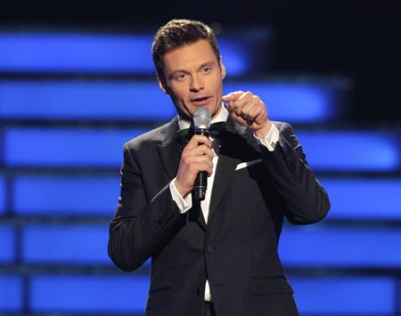 ''American Idol'' host Ryan Seacrest presides over the 11th season finale of ''American Idol'' in Los Angeles, California in this May 23, 2012 file photograph. REUTERS/Mario Anzuoni/Files