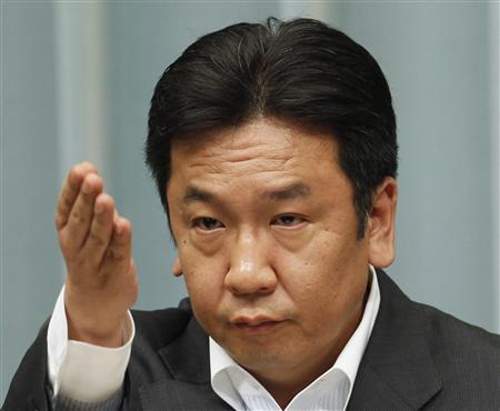 Japan's Trade Minister Yukio Edano points to a journalist, as he listens to questions raised during a news conference about the resumption of nuclear power operations in Japan, at Prime Minister Yoshihiko Noda's official residence in Tokyo June 16, 2012. REUTERS/Kim Kyung-Hoon
