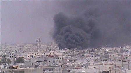 Smoke rises from Homs June 13, 2012. REUTERS/Shaam News Network/Handout