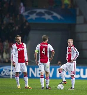 Ajax Amsterdam's Dmitri Bulykin (L), Jan Vertonghen (C) and Davy Klaassen react to the third goal of Real Madrid during their Champions League Group D soccer match at the Amsterdam Arena stadium December 7, 2011. REUTERS/Robin van Lonkhuijsen/United Photos