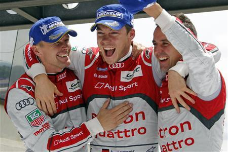 (From L to R) Audi R18 TDI number 1 drivers Marcel Fassler of Switzerland, Andre Lotterer of Germany, and Benoit Treluyer of France celebrate on their car after winning the Le Mans 24-hour sportscar race in Le Mans, central France June 17, 2012. REUTERS/Stephane Mahe