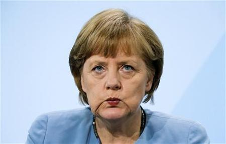 German Chancellor Angela Merkel reacts at a news conference after an energy ''summit'' with German state premiers at the Chancellery in Berlin May 23, 2012. REUTERS/Fabrizio Bensch