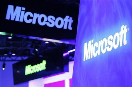 A variety of logos hover above the Microsoft booth on the opening day of the International Consumer Electronics Show (CES) in Las Vegas January 10, 2012. REUTERS/Rick Wilking