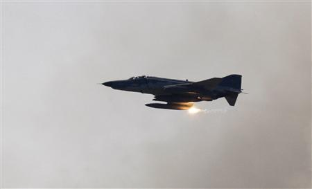 A Turkish Air Force F-4 war plane fires during a military exercise in Izmir, in this May 26, 2010 file photo. Turkey lost a F-4 warplane, similar to the one pictured, over the Mediterranean on June 22, 2012, but Turkish Prime Minister Tayyip Erdogan said in his first public comments, he could not say whether the plane had crashed or been shot down. REUTERS/ Osman Orsal/Files