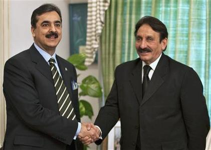 Pakistan's Prime Minister Yusuf Raza Gilani (L) shakes hands with Chief Justice Iftikhar Chaudhry, before a meeting at the prime minister's residence in Islamabad in this February 17, 2010 file photo. To his admirers, Chaudhry is a hero whose relentless pursuit of a money-laundering case against the president is teaching a generation of the country's leaders a long-overdue lesson in respect for the law. To his critics, he is a runaway judge in the grip of a messiah complex whose turbo-charged brand of activism threatens to upend the power balance underpinning Pakistan's precarious embrace of democracy. REUTERS/Mian Khursheed/Files