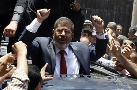 Presidential candidate Mohamed Morsy of the Muslim Brotherhood waves to his supporters after casting his vote at a polling station in a school in Al-Sharqya, 60 km (37 miles) northeast of Cairo in this June 16, 2012 file photo. REUTERS/Ahmed Jadallah/Files