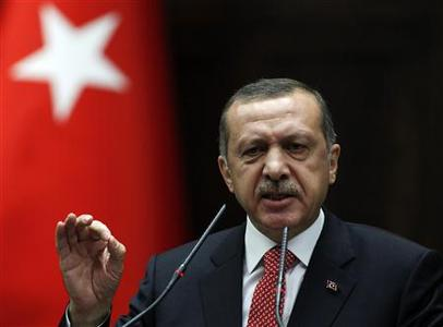 Turkey's Prime Minister Tayyip Erdogan addresses members of parliament from his ruling AK Party (AKP) during a meeting at the Turkish parliament in Ankara June 26, 2012. The Turkish Armed Forces' rules of engagement have changed as a result of Syria shooting down a Turkish warplane and they will respond to any violation on the Syrian border, Erdogan said on Tuesday. Turkey would not engage in war-mongering, but the attack on the reconnaissance jet, which was deliberately targeted, would not be left unanswered, he said in a speech to his ruling AK Party deputies in parliament. REUTERS/Umit Bektas