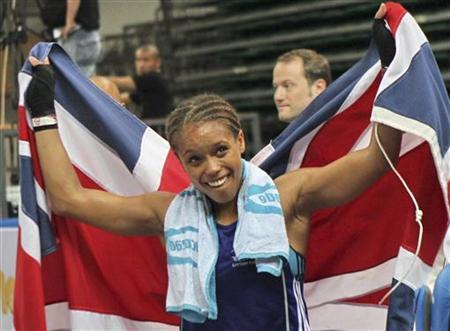 Natasha Jonas of Britain holds a British national flag as she celebrates after defeating Ingrid Egner of Norway during their women's 60 kg division quarter-final match at the AIBA World Women's Boxing Championships in Qinhuangdao, Hebei province May 16, 2012. REUTERS/China Daily