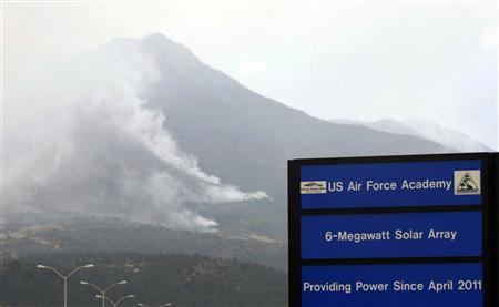 The Waldo Canyon Fire burns behind the U.S. Air Force Academy, west of Colorado Springs, Colorado June 27, 2012. REUTERS/Rick Wilking