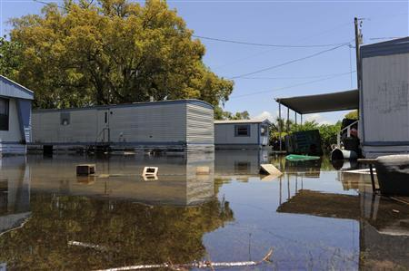 Floodwaters associated with Tropical Storm Debby begin to fall in this mobile home community in New Port Richey, Florida, June 27, 2012. REUTERS/Brian Blanco