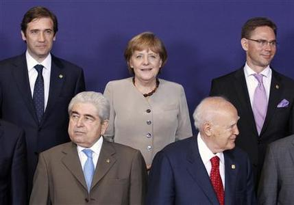 (Top row, from L-R) Portugal's Prime Minister Pedro Passos Coelho, German Chancellor Angela Merkel, Finland's Prime Minister Jyrki Katainen, (front row, L-R) Cyprus' President Demetris Christofias and Greece's President Karolos Papoulias pose during a family picture session for the two-day European Union leaders summit in Brussels June 28, 2012. REUTERS/Sebastien Pirlet