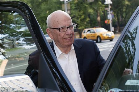 News Corp Chief Executive and Chairman Rupert Murdoch enters his vehicle as he leaves his home in New York June 28, 2012. REUTERS/Keith Bedford