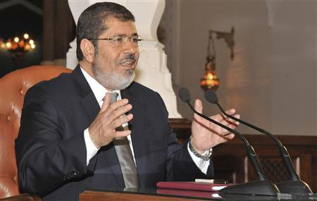 Egypt's President-elect Mohamed Mursi speaks during a meeting with the heads of Egyptian newspapers at the presidential palace in Cairo June 28, 2012. REUTERS/Egyptian Presidency/Handout