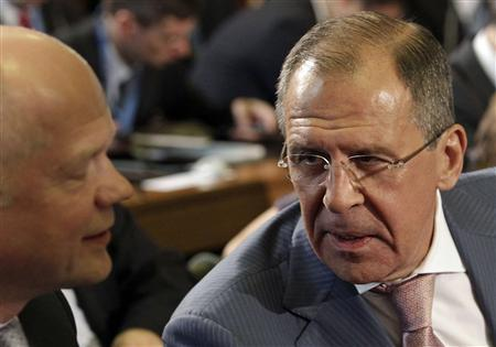 Russia's Foreign Minister Sergei Lavrov (R) speaks with his British counterpart William Hague before the start of the meeting of the Action Group on Syria at the United Nations European headquarters in Geneva June 30, 2012. REUTERS/Denis Balibouse