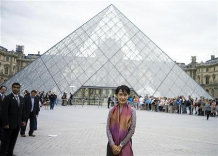 Myanmar pro-democracy leader Aung San Suu Kyi poses in front of the Pyramid of the Louvre Museum during a visit in Paris June 29, 2012. REUTERS/Fred Dufour/Pool