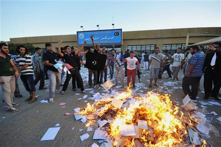 Protesters set fire to piles of voting materials after storming the office of the national election commission in Benghazi July 1, 2012. REUTERS/Esam Al-Fetori
