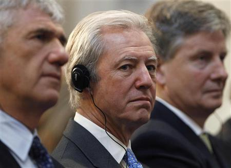 Barclays Chairman Marcus Agius listens as France's Prime Minister Francois Fillon delivers his keynote address at Guildhall in London in this January 13, 2011 file photograph. Agius is set to quit on July 2, 2012 as the interest rate rigging scandal takes its first major scalp and threatens to widen to other banks, raising questions about the involvement of the Bank of England. REUTERS/Suzanne Plunkett/Files