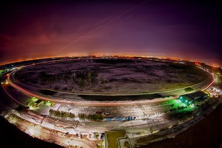 A night view of Fermilab's Tevatron accelerator outside Chicago, Illinois is seen in a February 8, 2011 handout photo. REUTERS/Fermilab/Reidar Hahn/Handout