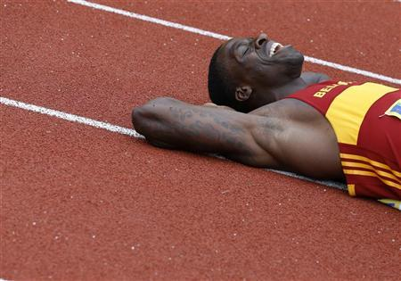 Dwain Chambers lies on the track after winning the men's 100 metres final at the British Olympic athletics trials at the Alexander Stadium in Birmingham , central England, June 23, 2012. REUTERS/Phil Noble