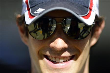 Williams Formula One driver Bruno Senna of Brazil stands outside his team garage during the first practice session of the Spanish F1 Grand Prix at the Circuit de Catalunya in Montmelo, near Barcelona, May 11, 2012. REUTERS/Felix Ordonez