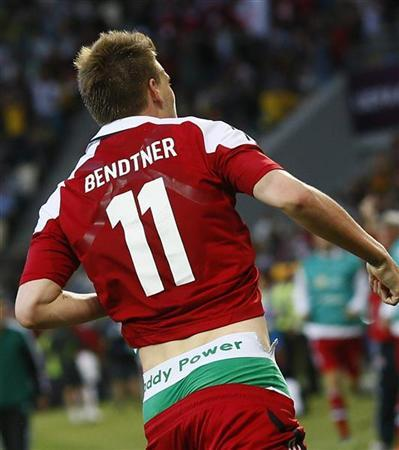 Denmark's striker Nicklas Bendtner runs on the pitch displaying the name of Irish bookmaking firm Paddy Power on the waistband of his underpants during their Group B Euro 2012 match against Portugal at the New Lviv stadium in Lviv June 13, 2012. REUTERS/Michael Dalder