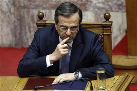 Greece's Prime Minister Antonis Samaras gestures during a parliament session in Athens July 6, 2012. REUTERS/John Kolesidis