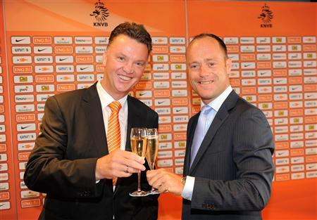 Soccer coach Louis van Gaal of the Netherlands (L) proposes a toast after being appointed as the new coach of the Netherlands with chairman of the KNVB, Bert van Oostveen (R) in Zeist July 6, 2012. REUTERS/Handout/KNVB