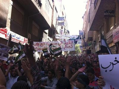 Demonstrators protest against Syria's President Bashar al-Assad in Yabroud, near Damascus, July 6, 2012. REUTERS/Shaam News Network/Handout