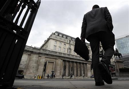 A man walks past the Bank of England, in the City of London June 15, 2012. REUTERS/Paul Hackett