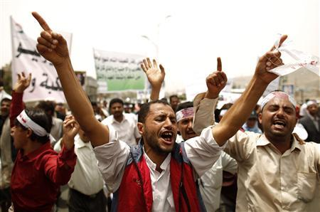 Protesters shout slogans as they demonstrate to commemorate the end of a 1994 civil war between South Yemen and North Yemen in Sanaa July 7, 2012. REUTERS/Khaled Abdullah