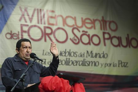 Venezuela's President Hugo Chavez (L) speaks during the Forum of Sao Paulo in Caracas July 6, 2012. Leftist political parties and non-governmental organisations are participating in this forum. REUTERS/Miraflores Palace/Handout